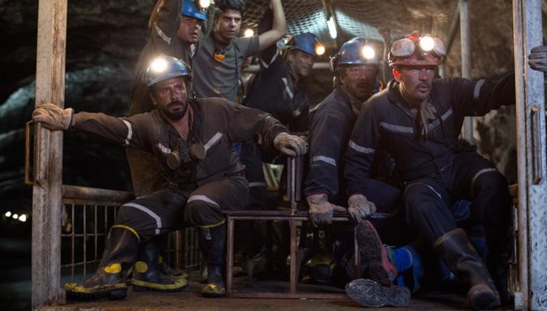 Miners suck underground chile