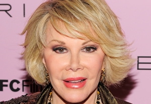 Joan Rivers Can't Get Off the Elevator