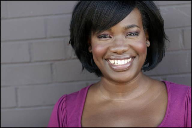 Maliaka Bell - Mali's Smiling Headshot
