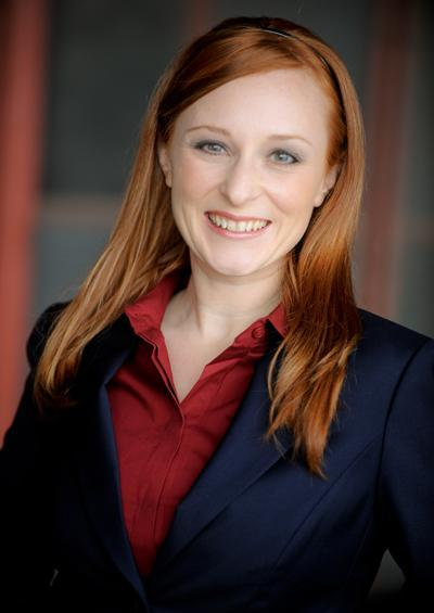 Carrie Lee Martz - Commercial Red Hair Navy Suit Burgundy Blouse