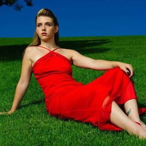 Dana Rampi-Cruz - Red Dress